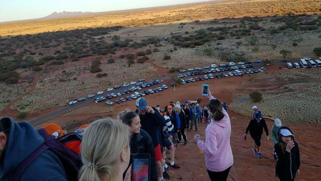 Tourists climbing Uluru in the final weeks before the climbing ban. Picture: @koki_mel_aus /AFP
