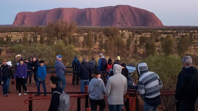 Large numbers of tourists are rushing to scale Uluru before the October 26 ban on climbing. Picture: @koki_mel_aus/AFP