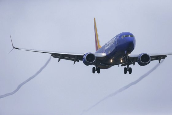 A Boeing 737 MAX 8 operated by Southwest Airlines arrives for a landing at Hobby Airport, Wednesday, March 13, 2019, in Houston. President Donald Trump issued an emergency order Wednesday grounding all Boeing 737 Max 8 aircraft in the wake of a crash of an Ethiopian airliner, a reversal for the U.S. after federal aviation regulators had maintained it had no data to show the jets are unsafe. (Yi-Chin Lee/Houston Chronicle via AP)