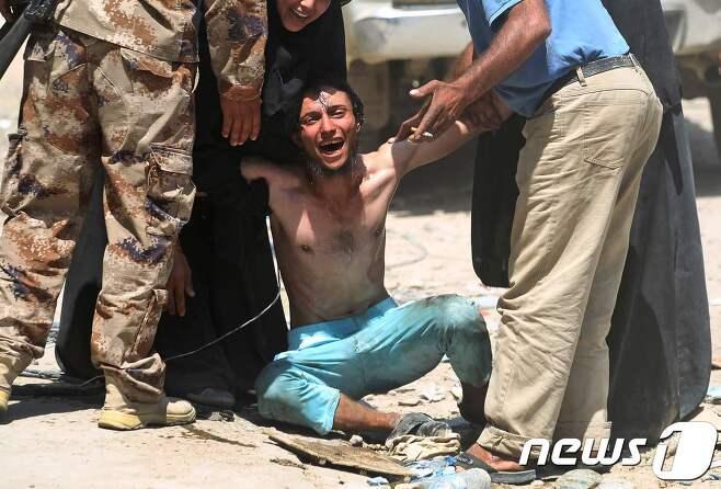 이라크 남부에서 총기난사·차량 공격이 발생해 최소 50명이 사망했다. 사진은 기사 내용과 무관. © AFP=뉴스1