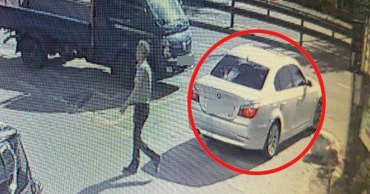 50대 부동산업자에 대한 납치살인 공범 중 1명이 지난 5월 20일 사체 유기장소인 주차장에 가기 전 용의 차량(빨간색 원)에서 내린 모습. [뉴시스]