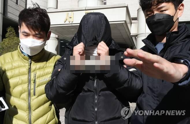 영장심사 마친 텔레그램 성착취물 유료채널 운영 20대 [연합뉴스 자료 사진]