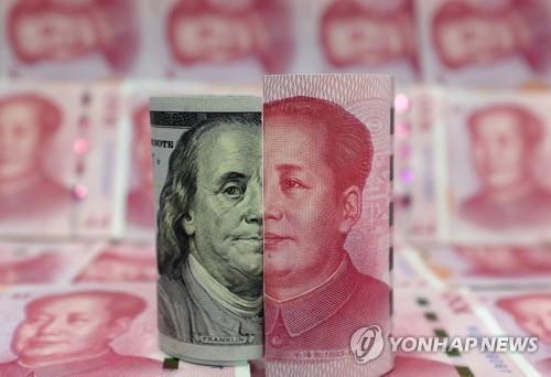 위안화와 달러화 지폐 [로이터=연합뉴스 자료사진]