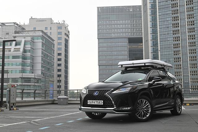 더욱 커진 차체, 루프 톱 텐트 등을 얹은 렉서스 RX L은 '하이브리드 SUV'의 매력을 제시했다.