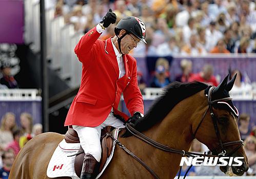 [런던=AP/뉴시스]역대 올림픽 최다 10회 출전에 빛나는 캐나다 승마의 이안 밀러.